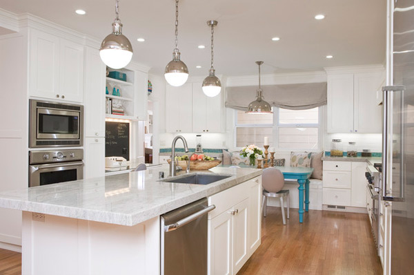 Elegant White Kitchen With Beautiful Hanging Lamp And Bright Lighting