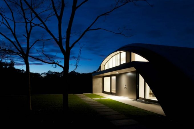 Exterior Design Of Arc House Night Facade With Bright Lighting Green House Design