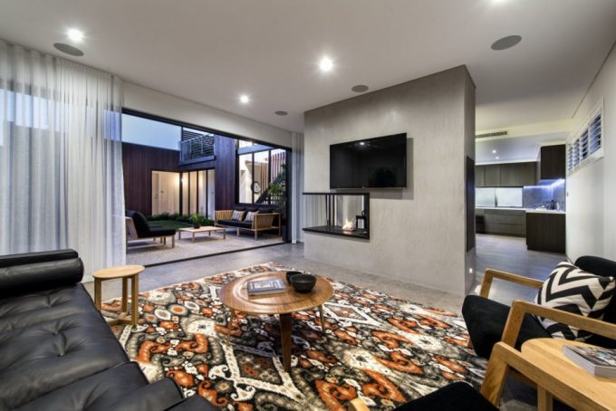 Family Room With Black Leather Couch Mosern Fireplace And Wide Sliding Glass Door