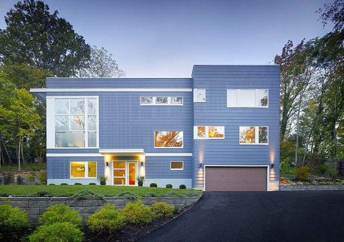 Front Facade Exterior With Light Blue And Glass Modern Three Story House Design