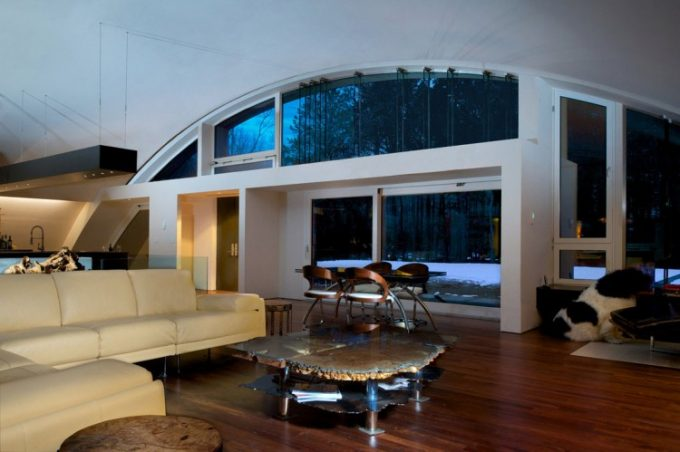 Futuristic House Design With Modern Interior Design Of Hard Wooden Flooring And Comfortable White Couch