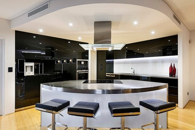 Futuristic Nuance In Kitchen Space With Glossy Black Countertop And Kitchen Cabinet Also Silver Kitchen Island