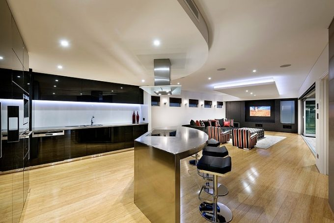 Glossy Solid Black Kitchen Cabinet And Hard Wood Flooring Details