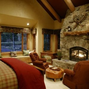 Interesting Rustic Bedroom Decor With Rustic Stone Fireplace And Vintage Color Furniture