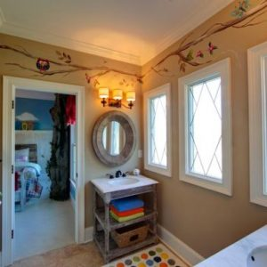 Kids Art Pictue And Colorful Bathroom Rugs With An Open Shelf And A Cute Towel Rack Stand Out In This Cute Kids Bathroom Space