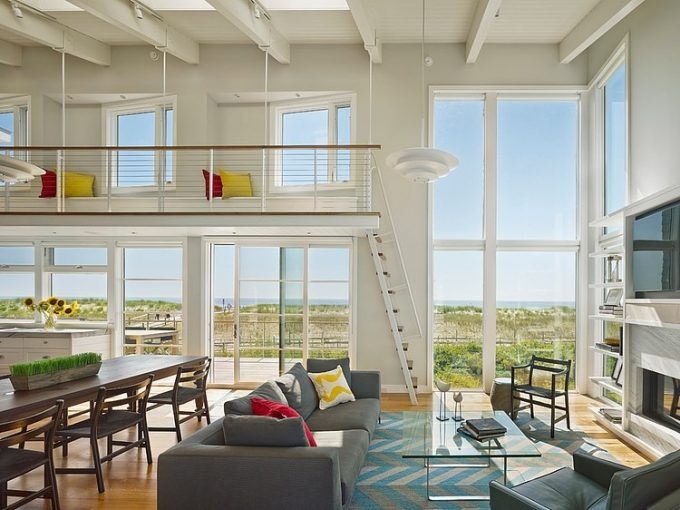 Large Floor To Ceiling Windows And Awesome Bay Window Design With Beautiful Beach Scenery