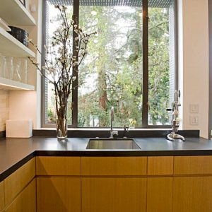 Lovely Black Laminate Countertop In A San Francisco Kitchen With Wood Cabinetry