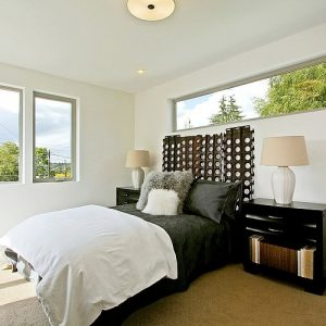 Lovely Bright Bedroom Design With Window Around The Room And White Interior Also Chocolate Carpet