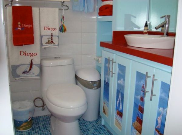 Marine Theme Bathroom Smart Use Of Art And Stenciled Cabinets Try And Bring Home The Beach Into This Bathroom