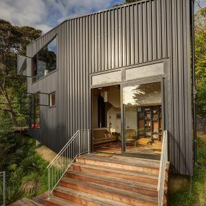 Metal Exterior And Wooden Enterence Design Beautiful Small Holiday House Design