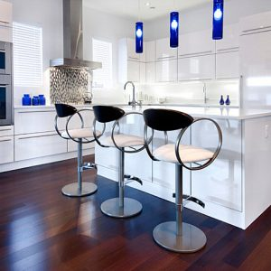 Modern Clean Lined Kitchen With Cobalt Accents And Stylish Barstool Seating