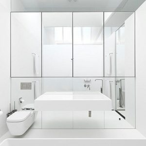 Modern Mirrored Storage In A Contemporary Bathroom With White Interior Bathroom