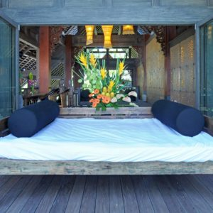 Peaceful Puri Ikan Terrace With Vintage Wooden Lounge Bed Design And Wooden Floor