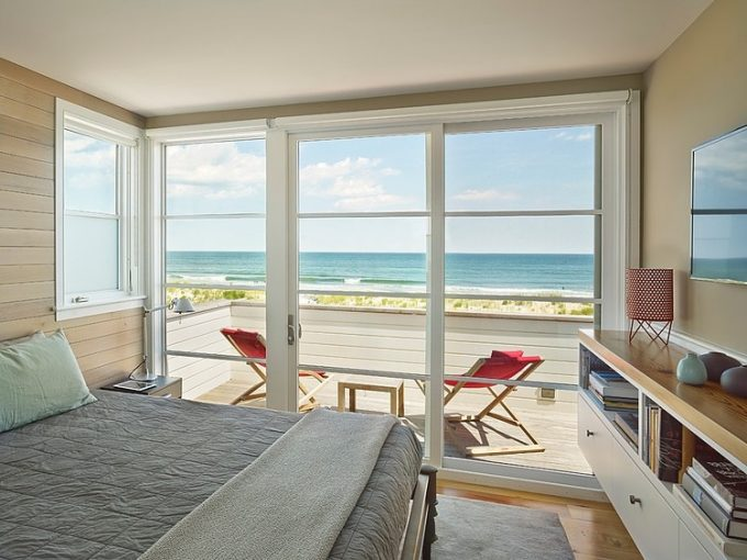 Soft Color Bedroom With Peaceful Sea View From The Glass Window