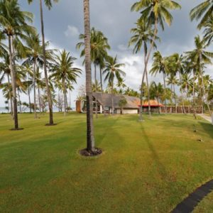 Villa Sapi Beautiful Beach Landscaping With Green Grass Coconut Tree And Beach Backsplash