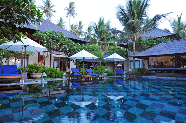 Villa With Traditional Bali Houses Surround By Lush Green Trees