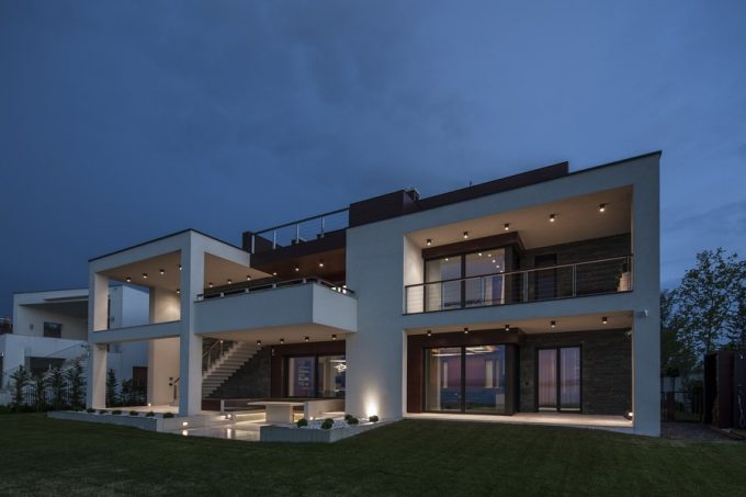 White Dominate The Exterior Design Of Big Summer Cottage Design In Contemporary Lake Side Duplex House