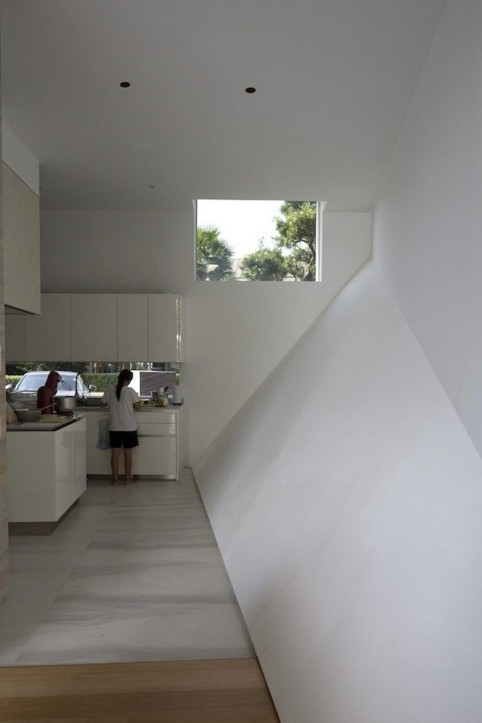 White Kitchen And Slope Wall Interior