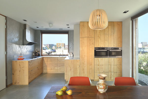 Modern Wood Kitchen With Wooden Cabinetry And Wooden Eating Table