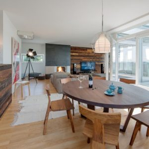 Wooden Beams Counters With Wooden Dining Furniture In Natural Penthouse Design