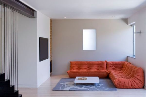 Beautiful Orange Sofa And Ergonomic Togo Is A Perfect Fit For The Modern Apartment Decor
