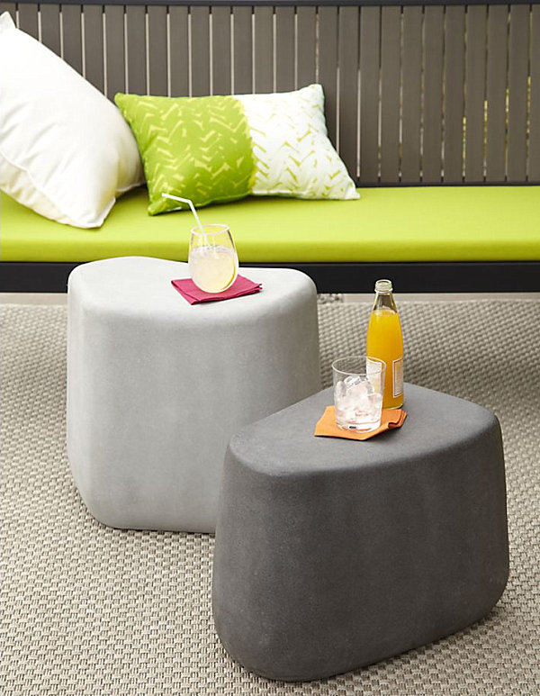 Elegant Stone Stools And Side Tables With Green Chair Cover