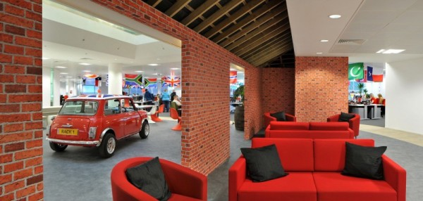 Fake Brick Wallpaper And Red Sofa In British Style Office Design