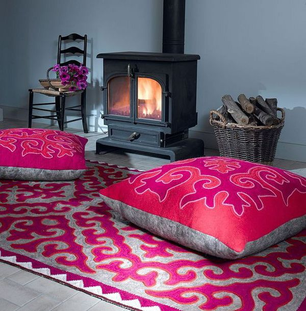 Fireplace Area With Pink Rugas An Pink Floor Pillows