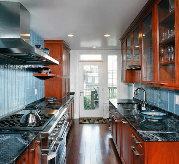 Galley Kitchen Dark Wood And Marble Counters Also Front Glass Cabinets