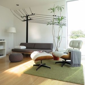 Interesting White Lounge Chair With Green Rugs And Cool Wall Decals Make A Beautiful Backdrop For The Eames Lounge And Ottoman