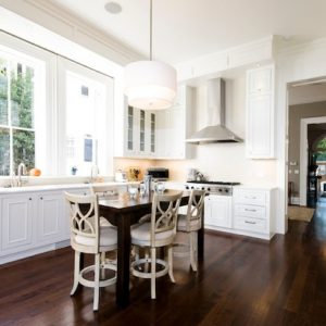 Kitchen White Cabinetry And Wall With Glass Windows And White Pendant Lamp