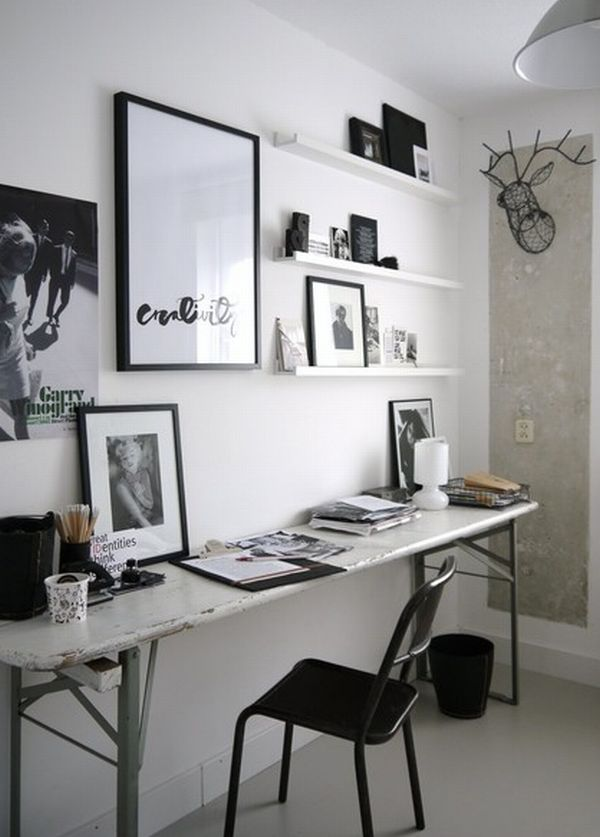 Simple Home Office With Narrow Desk And Wall Pictures