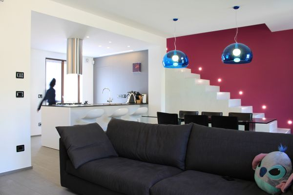 Stylish Blue Pendant With Pops Of Color In The Living Room