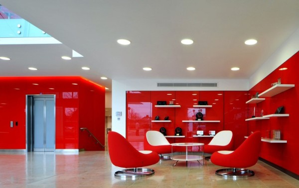 The Waiting Room Design With Glossy Red And White Office Design