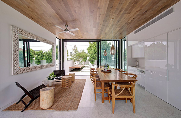 White Glossy Counters With Wood And Rattan Dining Furniture