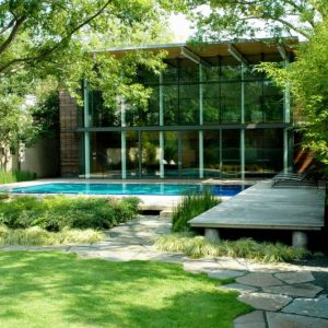 Amazing Green House Design With Green Landscape And Beautiful Pool