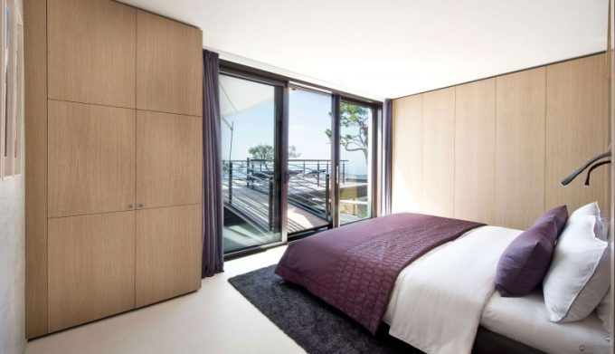 Awesome Bedroom With Laminated Wood Cabinetry And Walkway Ro Balcony