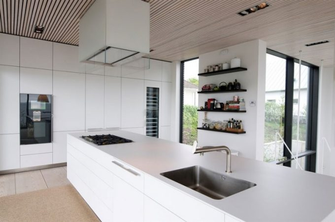Beautiful Kitchen Island With Cool Faucet And Wall Shelving In Modern Villa Design