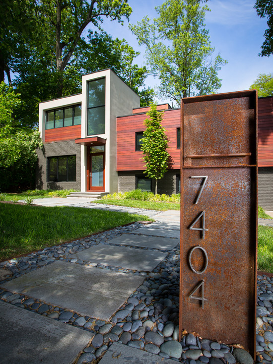 Contemporary Exterio With Steel Mounted Mailbox With House Numbers Also Concrete Path With Gravel Stone And Lawn