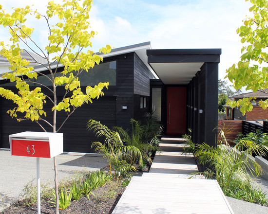 Contemporary Exterior With Modern Fence Mounted Mailbox And Concrete Path In Modern House Design