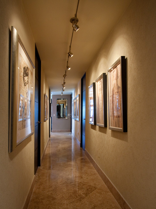 Contemporary Hall With Art Paintings And Picture Rail Lighting Also Beige Marble Flooring