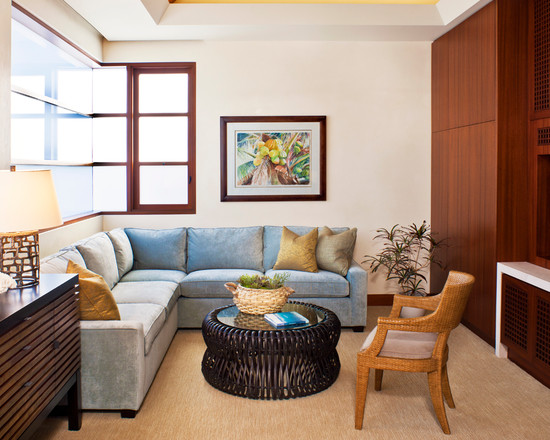 Cool Small Family Room Furniture Arrangement With Blue Sectional Sofa Wood Cabinets Also Round Table