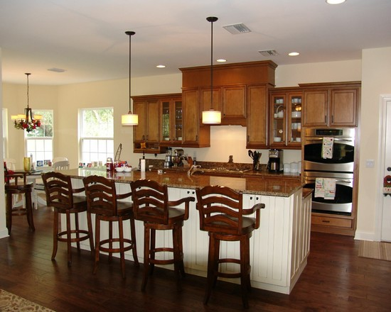 Dark Hardest Wood Flooring In A Kitchen Area With Rustic Stool And Wood Counters Kitchen Sland Also Wood Kithcen Cabinetry Plus Pendants