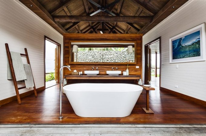 Large Bathroom With White Sandtub With Wood Floor And Open Bathroom Design