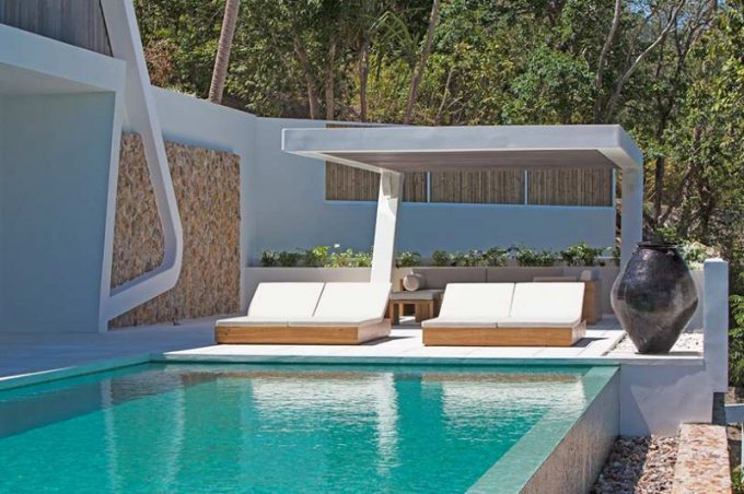 Lounge Chair For Sun Bathing And Concrete Pergola