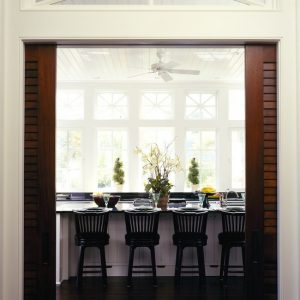 Lovely Kitchen Design With Twin Sliding Wooden Pocket Doors And Eat In Kitchen Style