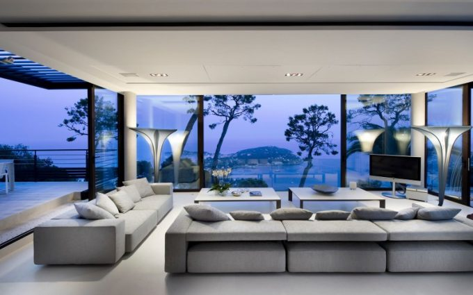 Luxuty Livingroom With Floor To Ceiling Windows And Grey Sofa In Bayview By Marc Berenguer