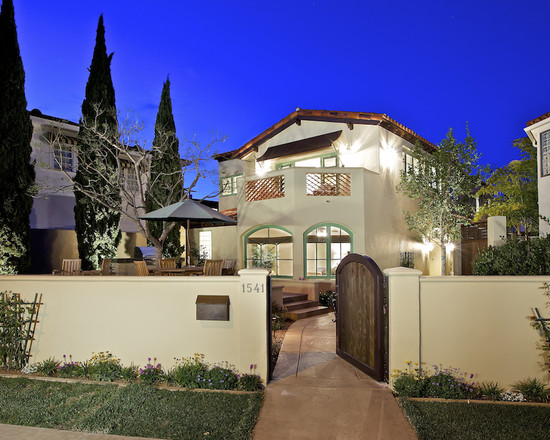 Mediterranean Exterior With Fence Mounted Mailbox And Beige Fence Also Pathway Entry