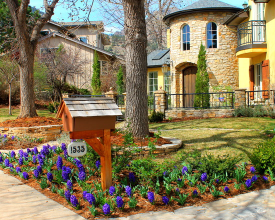 Mediterranean Exterior With Lovely Garden And Birdhouse Mounted Mailbox And Walkway Also Curb House Appeal