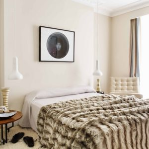 Midcentury Bedroom With Furry Area Rugs And Furry Bedding Also White Wall